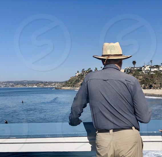 Portrait Without a Face Challenge Senior Man on a Pier With Hat Enjoying his Retirement Seniors Senior Citizen Retirement Water Pier Ocean View Hat  photo