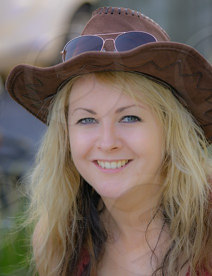 A very soft focus portrait of a pretty lady in a cowboy hat. photo