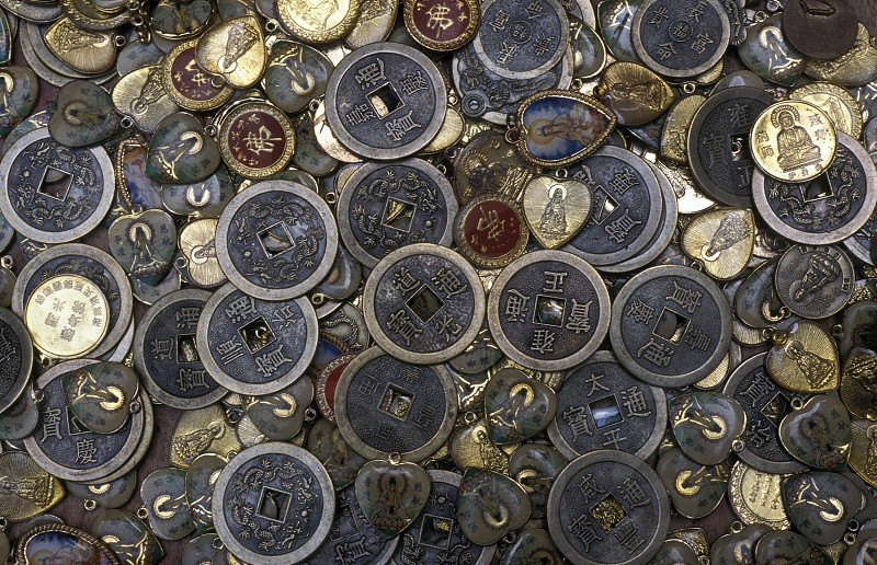 religion coins at a market street in the city of Chongqing in the province of Sichuan in china in east asia.  photo
