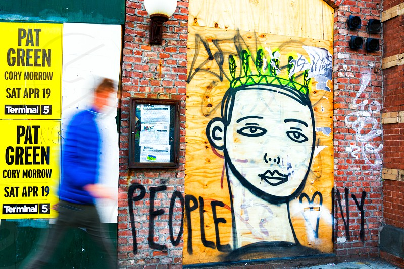 person wearing green crown graffiti photo