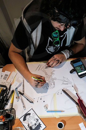 student artist drawing photo