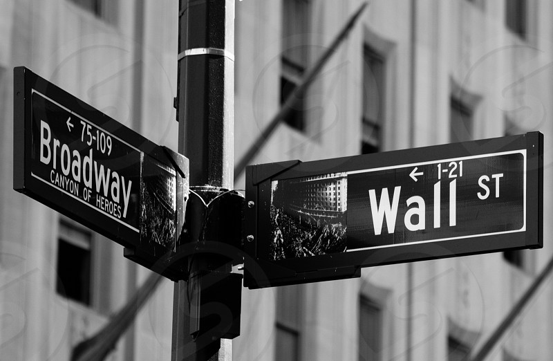 broadway canyon of heroes and wall st signage grayscale photography photo