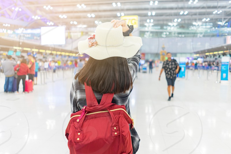 Young traveler girl at the airport. wanderlust style. photo