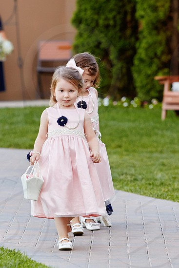 Flower girls wedding walking down the isle bridal party wedding day the day adorable pretty in pink photo