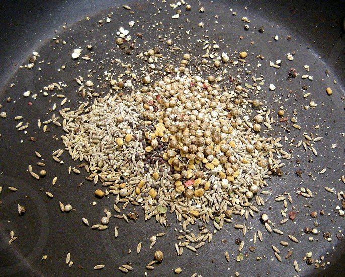 Whole Indian spices in skillet photo