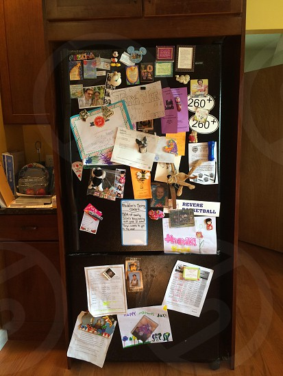 black refrigerator with stickers photo