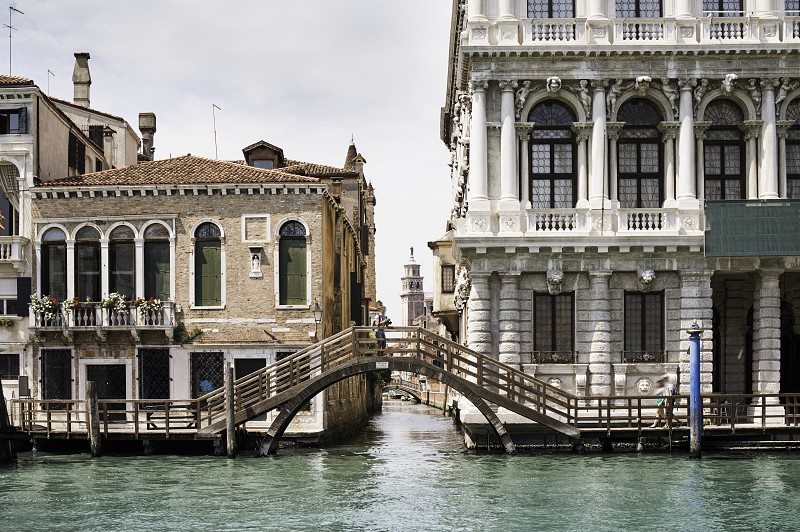 Ancient buildings in Venice. Boats moored in the channel. View from the side of the water photo
