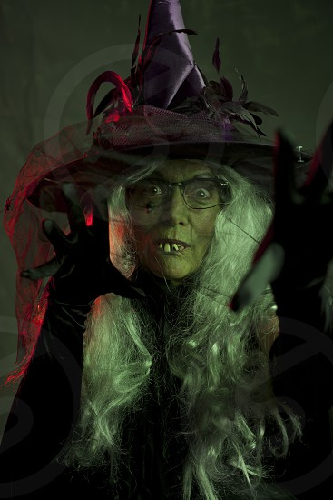 woman wearing a witch costume with eyeglasses photo