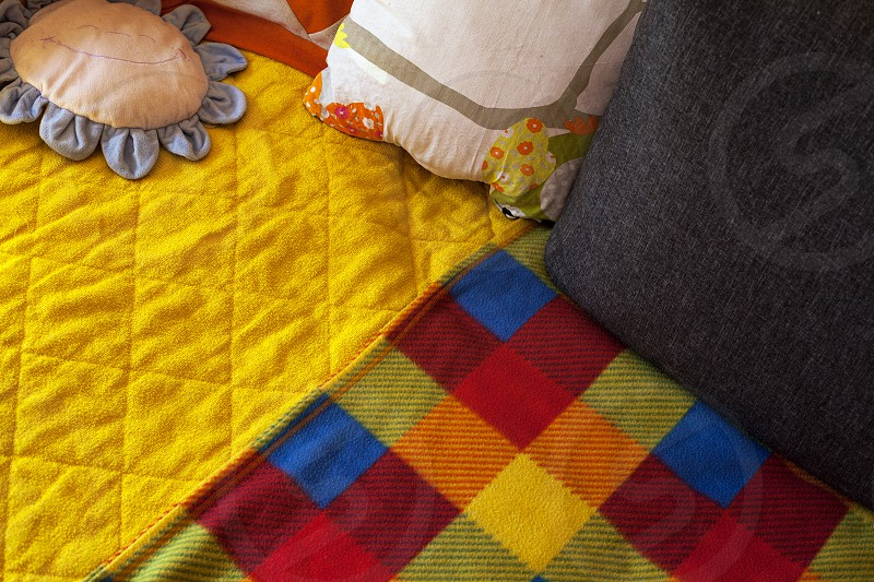 Details of colorful blankets and pillows closeup view. photo