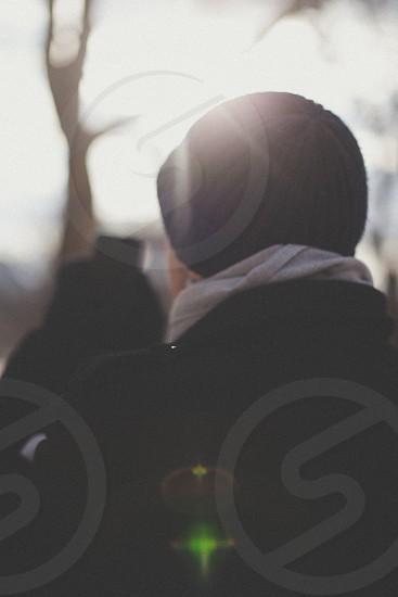 person wearing black beanie photo