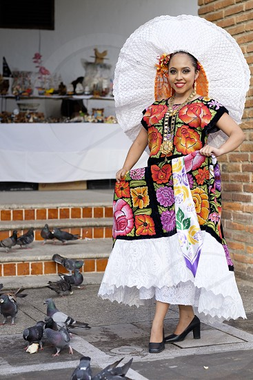 Traditional Mexican folklore outfit. Puerto Vallarta Jalisco Mexico. Xiutla Dancer - a folkloristic Mexican dancer in traditional costume representing the culture and different regions of Mexico. photo