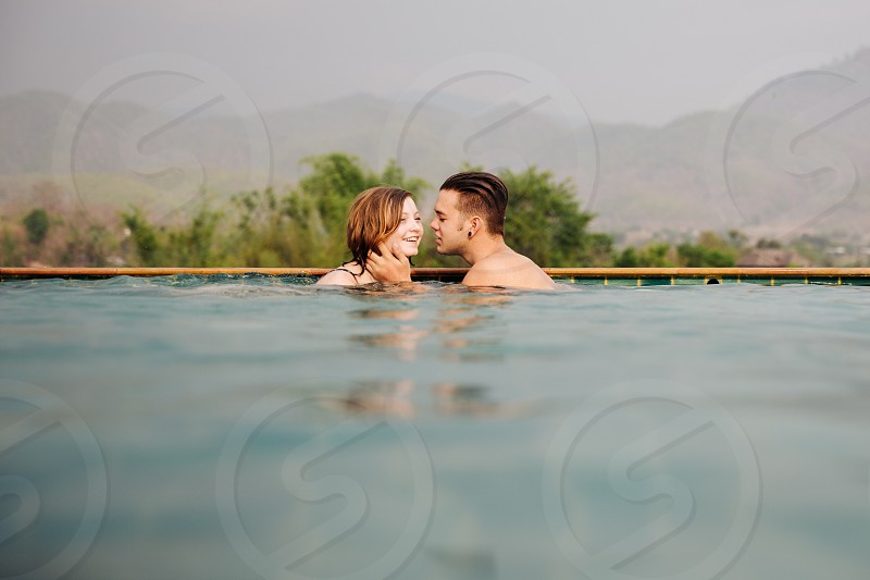 woman and man on swimming pool photo