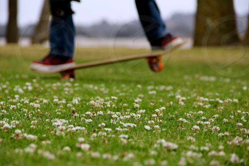 A young boy plays on his lawn. photo