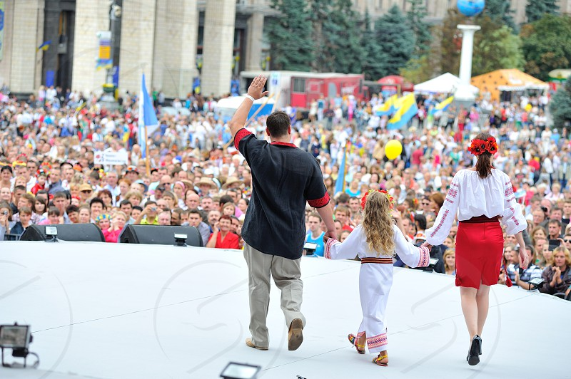 KIEV UKRAINE - AUGUST 24: People in national costumes show their outfits on the stage at the All Ukrainian Vyshyvanka Parade on Maidan at Independence Day on August 24 2013 in Kiev Ukraine. photo