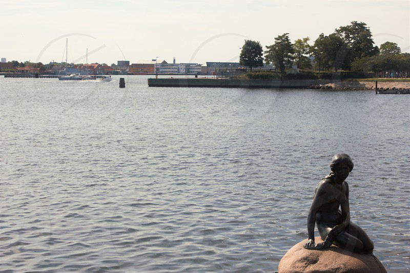 The Langelinie Promenade. Copenhagen Denmark.  Langelinie Pier.  The Little Mermaid Statue.  photo