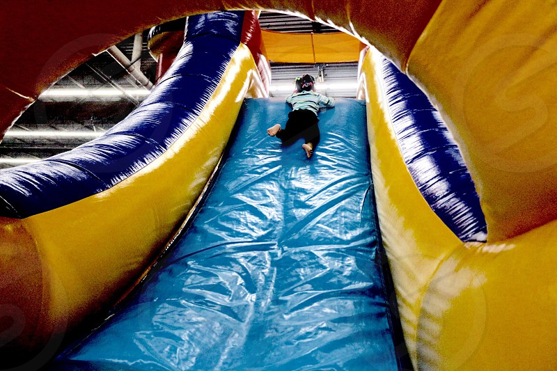 Child on inflatable slide photo