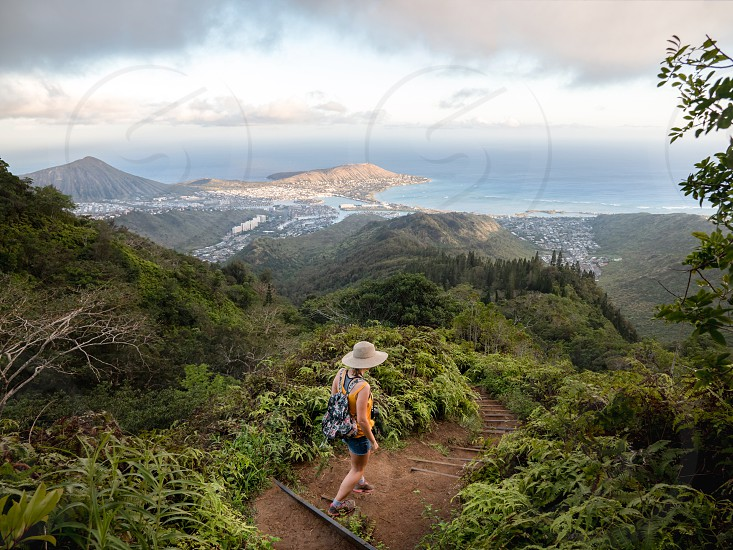 Woman hike in nature coming down a trail stairs Kuliouou ridge adventure environment lifestyle Hawaii  photo