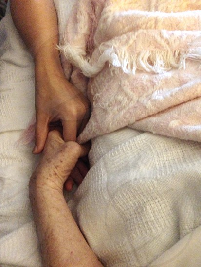 holding hands on blanket photo