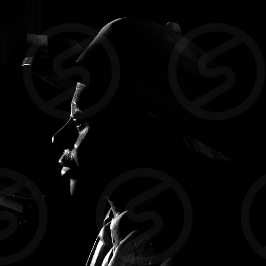 man in black cap photo