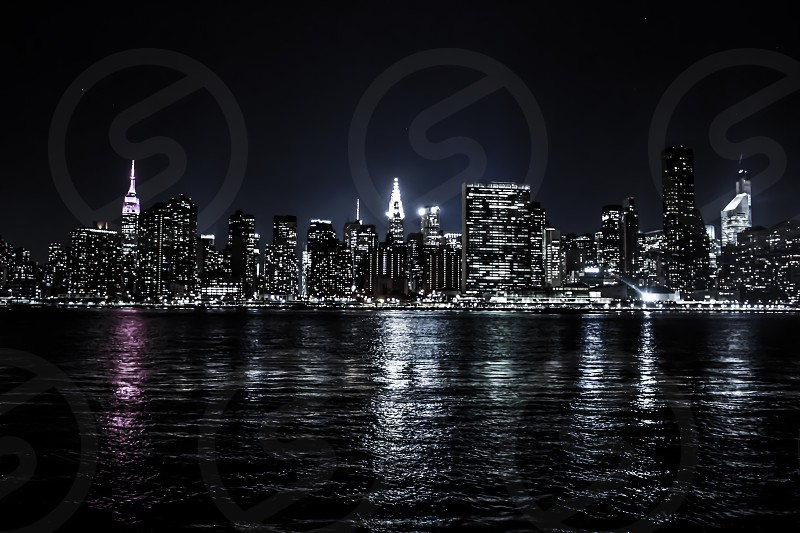 city buildings with lights on photo