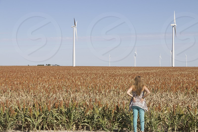 woman standing on the brown fields photo