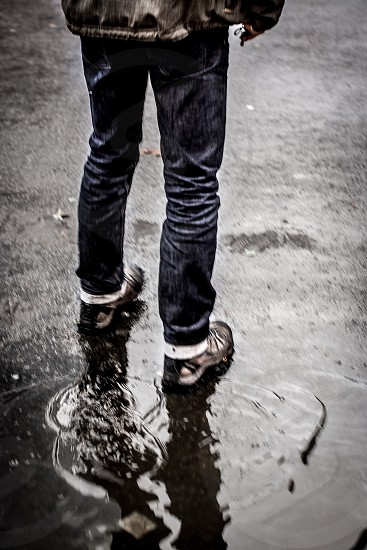 Wet Feet - feet jeans New York New York City NYC puddle rain shoes wet reflection photo