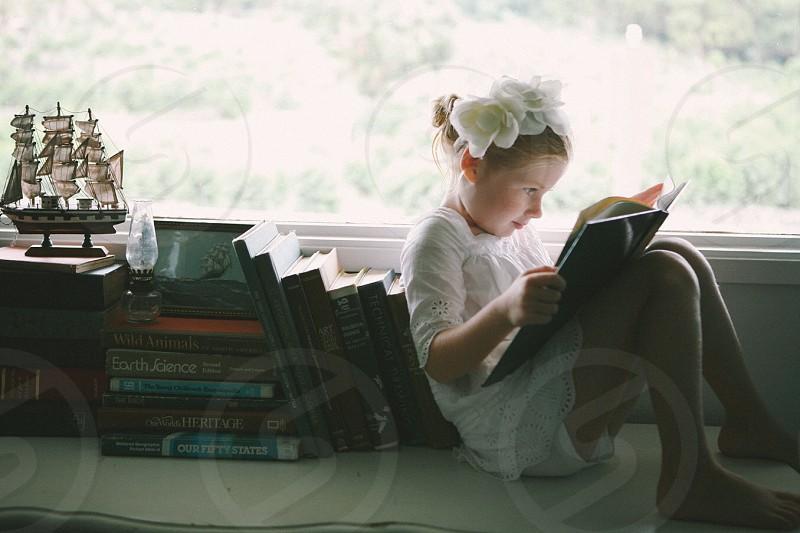 Vintage little girl reading read learn education books home imagination kid child photo