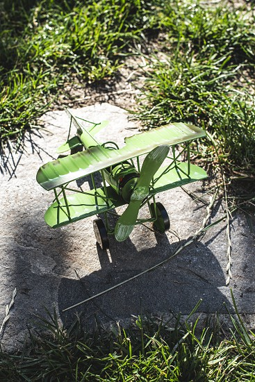 Plane toy in the garden. Sunny day photo