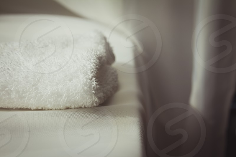 White towel on white cloth background. photo
