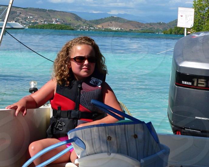 Girl on boat photo