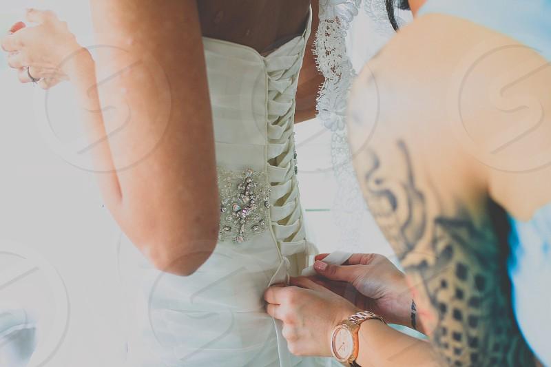 white diamond embellished strappy back wedding dress photo