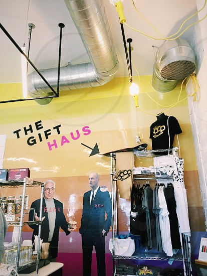 standees of men wearing black formal suit and black blazer near the gift haus photo