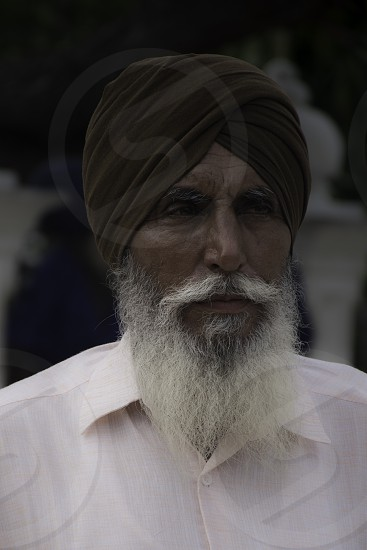 Man with white beard and mustache in turban in India. photo