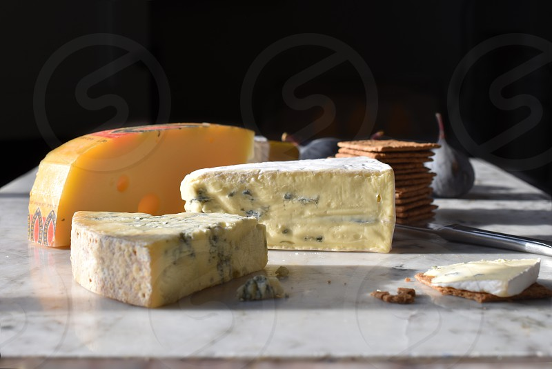Selection of cheeses on a marble worktop. photo