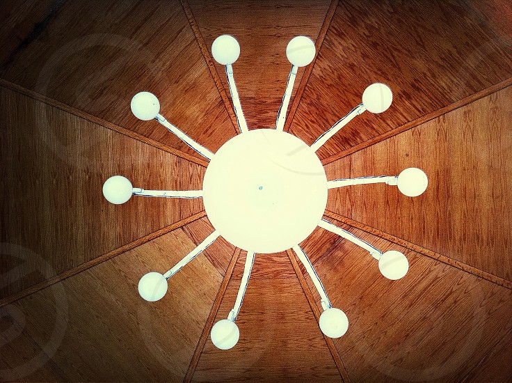 white chandelier under wooden ceiling photo