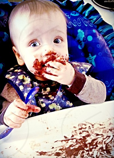 Toddlers mealtime messy eating high chair bib snacking photo