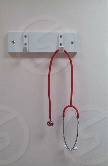 A small stethoscope for listening to a newborn babys heart beat. photo