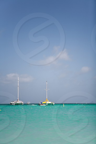 Caribbean clear blue water catamaran. photo