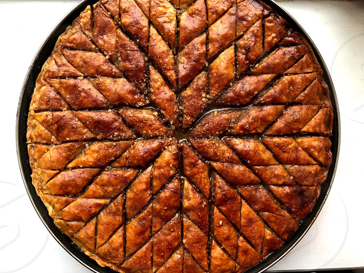 Baklava as the sun. Eastern sweets. Mathematical approach. Food symmetry and norms  photo