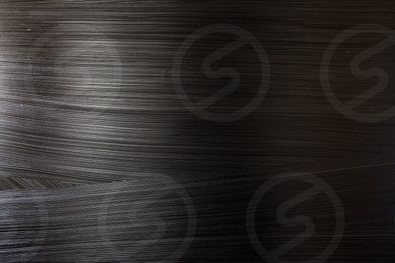 Elegant dark background with spatulated textures and reflections of light photo