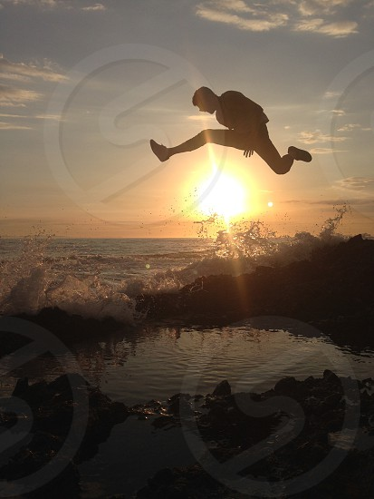 man jumping  photo