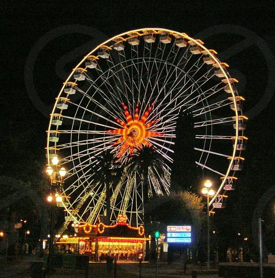Orange funfair Ferris wheel photo