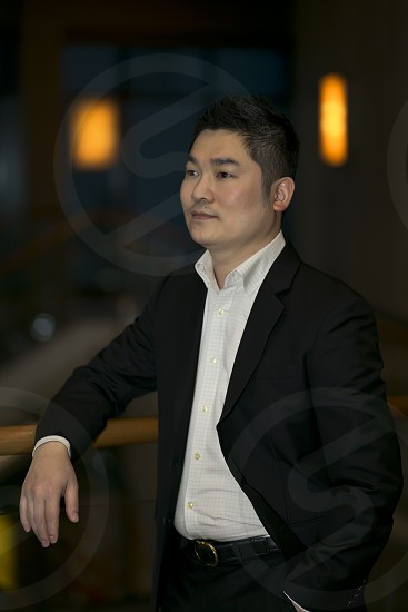 Portrait of an Asian business man wearing smart casual suit posing photo