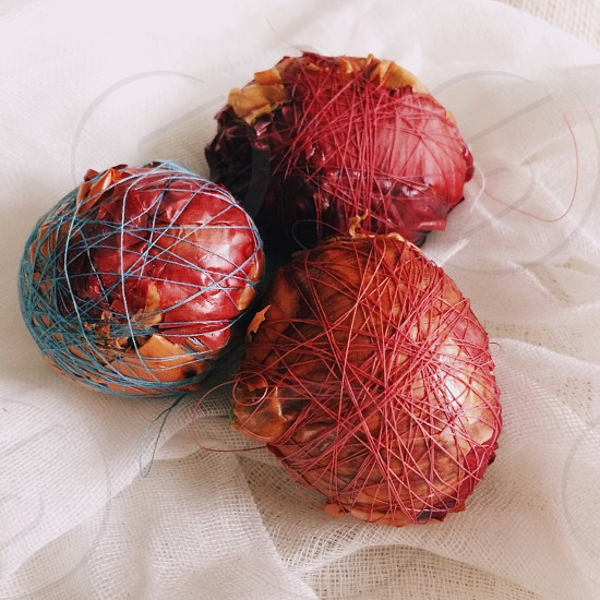 Eggs wrapped in onion skins to be boiled and naturally dyed photo
