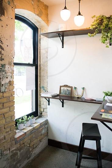 black wooden rectangular stool near black frame glass window photo