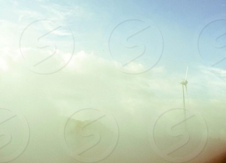 white wind turbine with mist  photo