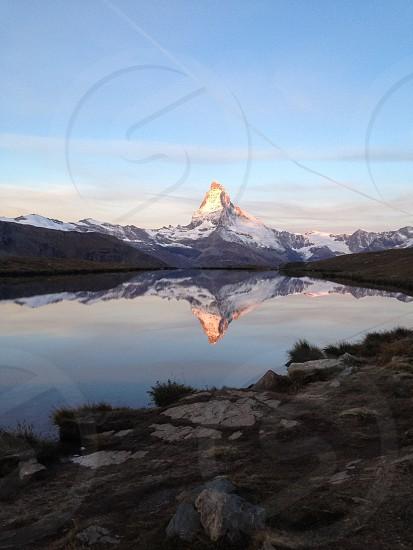 lake on mountain foot photo