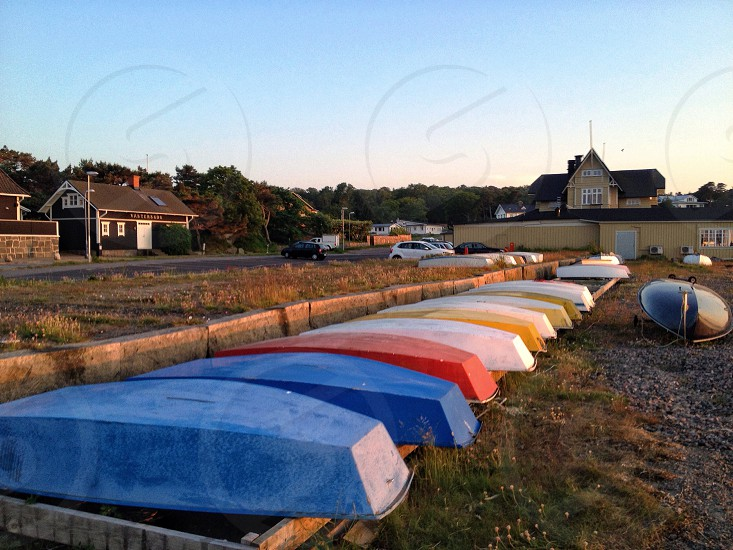 inverted boats on the ground photo