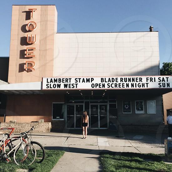 lambert stamp blade runner fri sat slow west open screen night sun sign photo
