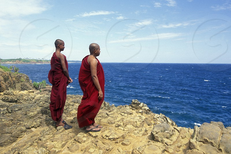a beach at the coast of Hikaduwa at the westcoast of Sri Lanka in Asien. photo